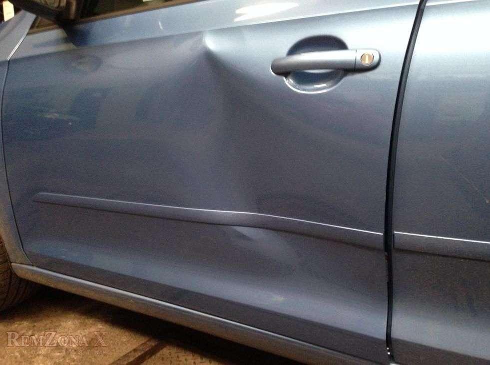 Вмятина на двери машины фото